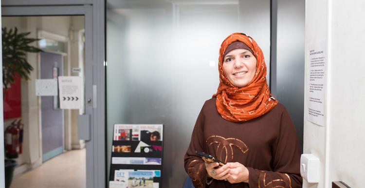 Image of female holding mobile phone