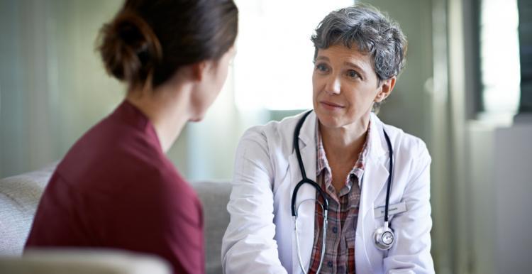 women talking to doctor