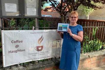 Image of Cathryn from Darlington Methodist Church stood holding suicide prevention tin